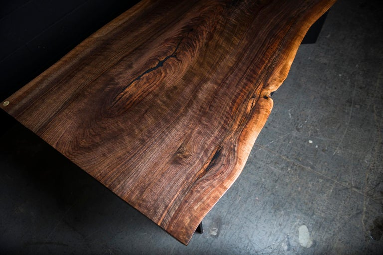 Our Frankin Live edge dining table is handmade to order from a one-of-kind walnut slab with an hand rubbed natural oil and wax finish that enhance the real beauty of the wood and give a natural warm touch. The elegant style came from our signature