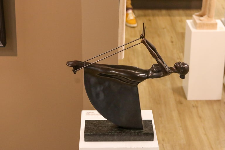 Swinging III - 21st Century Contemporary Bronze Sculpture of a Woman On A Swing For Sale 1
