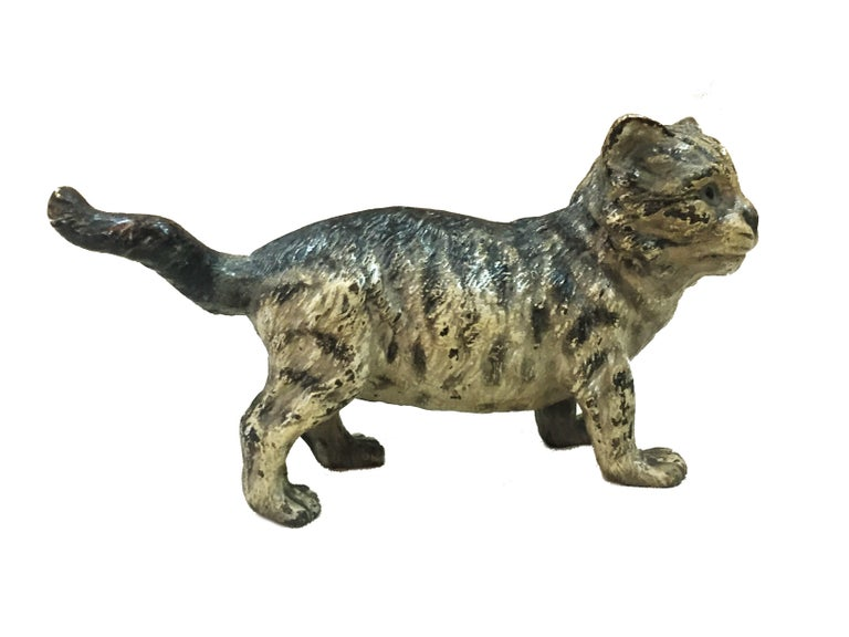 This highly collectible miniature desk sculpture of a cat is made of cold-painted bronze in the best traditions of the world-famous Viennese foundry of Franz Xavier Bergman.   The black-gray-white coloration of the cat looks so natural that, if it