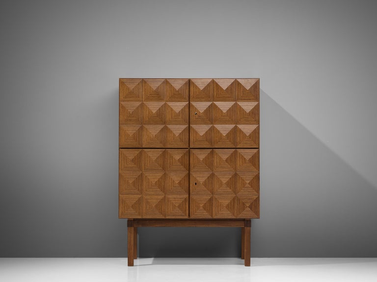 Franz Meyer, highboard, rosewood, Germany, 1960s  Subtle 'brutal looking' highboard by master furniture maker Franz Meyer from the 1960s. The four doors of this cabinet feature a diamond-shaped structure, which highlights the rosewood in an
