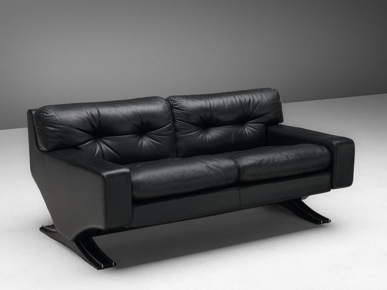 Franz T. Sartori, two-seat sofa, leather, lacquered wood and chrome, Italy, 1970s.  Bulky and lush sofa that you just want to tuck into. Great design by the Italian sculptor Franz T. Sartori. The sofa has a strong appearance due to the straight