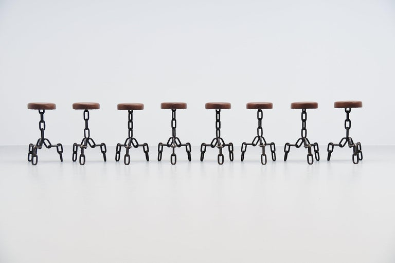 Very nice and cool set of 8 stools in the manner of Franz West, Holland, 1970. The stools have wrought iron chain shaped bases, fully hand welded. We have restored the seats and reupholstered them with brown leather. The stools have a great patina