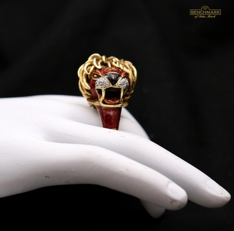 A whimsical and ferocious big cat ring in 18K yellow gold, by Frascarolo. The muzzle of this beast is set with 1/5 of a carat of diamonds, and a combination of red and black enamel gives this artistic ring sharp detail. This signed piece is a size 6