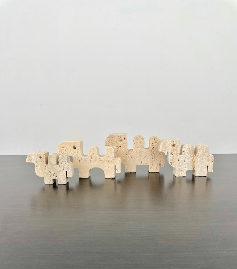 Set of four camel dromedary sculptures in travertine marble and in different measures by Fratelli Mannelli, Italy, 1970s.   Measures: - 1st one: width 12.5 cm, height 8 cm, depth 2 cm. - 2nd one: width 12 cm, height 7 cm, depth 2 cm. - 3rd one: