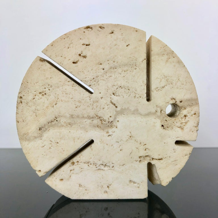 Letter holder or paperweight in travertine in the shape of a puffer fisher made by the Italians Fratelli Mannelli.  The sculpture has its original label on the bottom.  As the photos show, there is a tiny chipping down on one side.