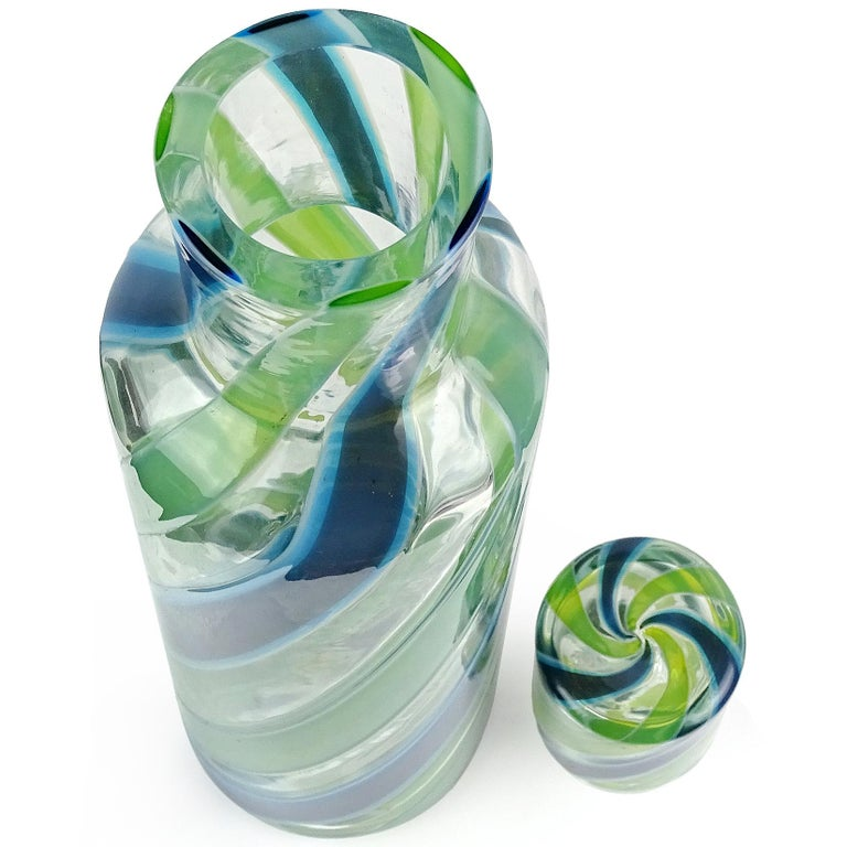 Monumental, vintage Murano handblown blue and green ribbons Italian art glass decanter. Documented to the Fratelli Toso company, with original Murano label underneath. Retains its original stopper. The piece is made of very thick glass. Similar one