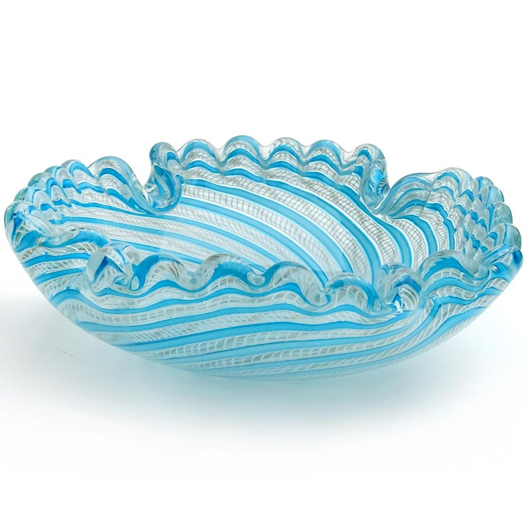Beautiful Murano hand blown blue ribbons, white Zanfirico with aventurine Italian art glass decorative bowl. Documented to the Fratelli Toso Company. The piece has a scalloped rim, with squared shape and folded in corners. Measures: 7 3/4