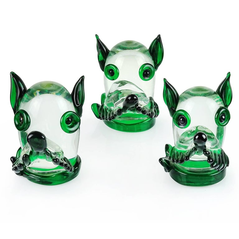 Priced per item (three available). Cute Murano handblown green and clear Italian art glass puppy dog head sculpture or paperweight. Documented to the Fratelli Toso company. The dog has a tied handkerchief around its neck. Original Murano label still