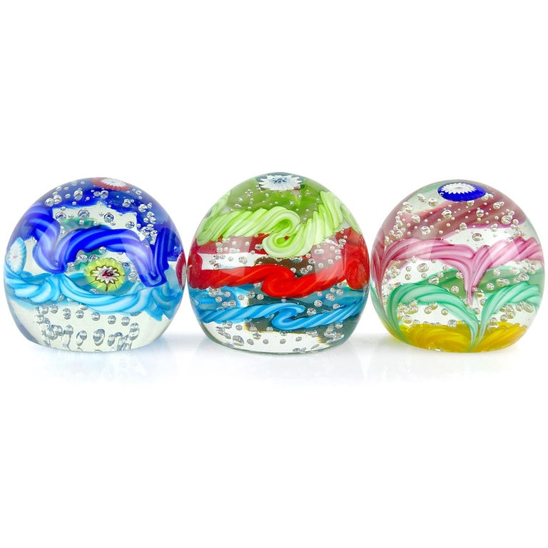 Priced per item (3 designs available). Beautiful and colorful vintage Murano hand blown twisted cotton candy ribbon Italian art glass crown paperweights. Documented to the Fratelli Toso company. Each has their own unique design, with clear bubbles