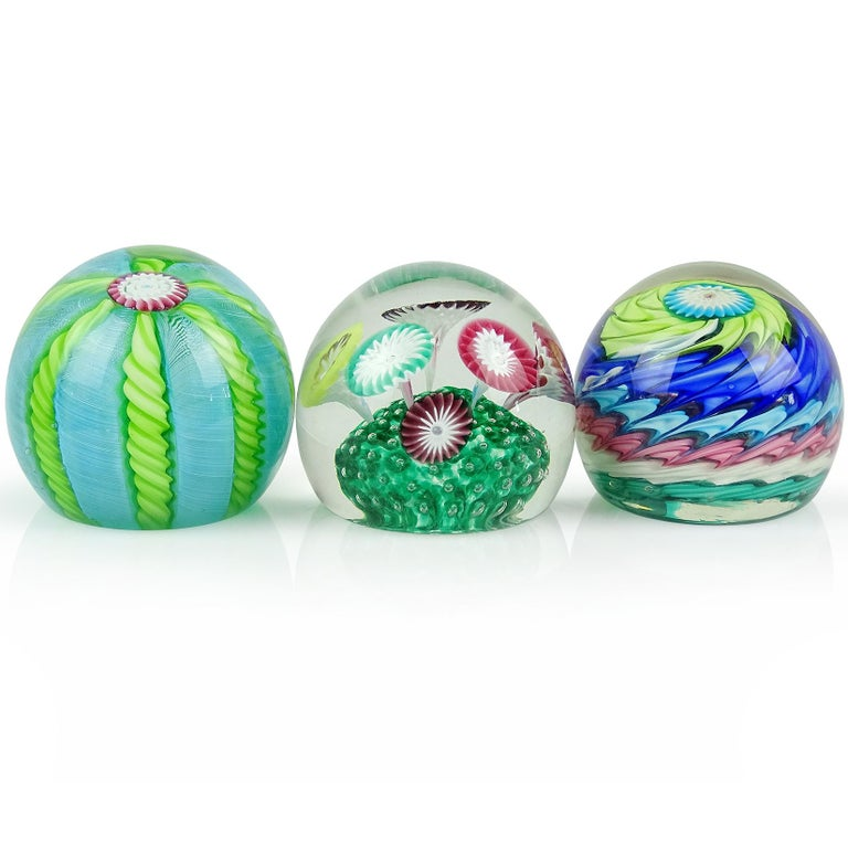 Priced per item (3 avail. as shown). Beautiful and colorful vintage Murano hand blown Italian art glass paperweights. Documented to the Fratelli Toso company. Each has their own unique design. The first one is a