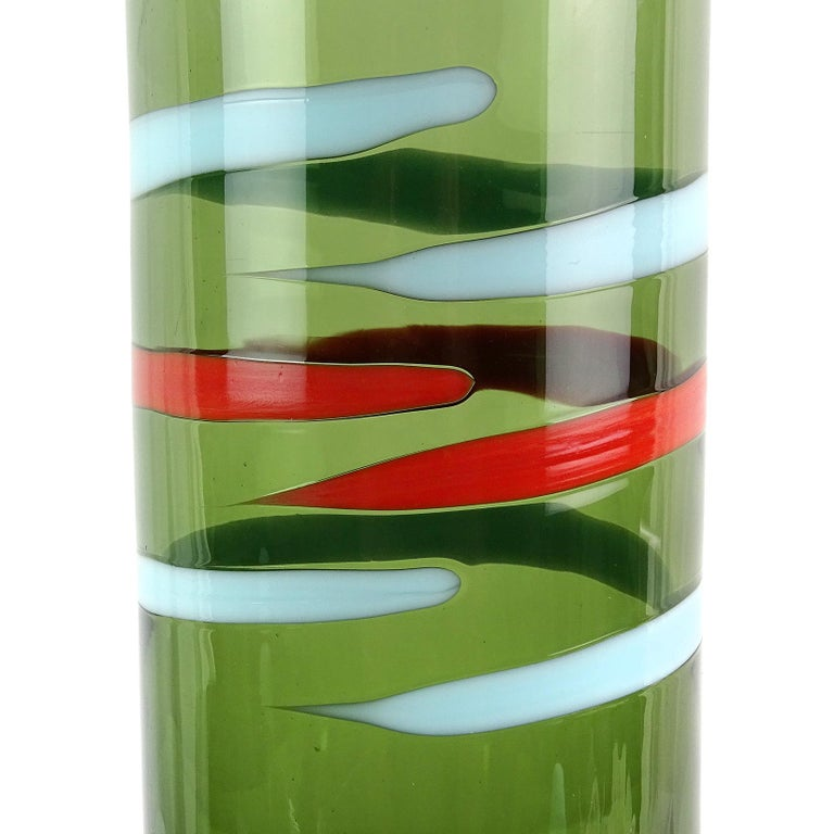 Beautiful vintage Murano hand blown green body, with red and blue stripes Italian art glass decanter. Documented to the Fratelli Toso Company. Retains its original ball stopper, matching the blue in the stripe. Great graphic design and color