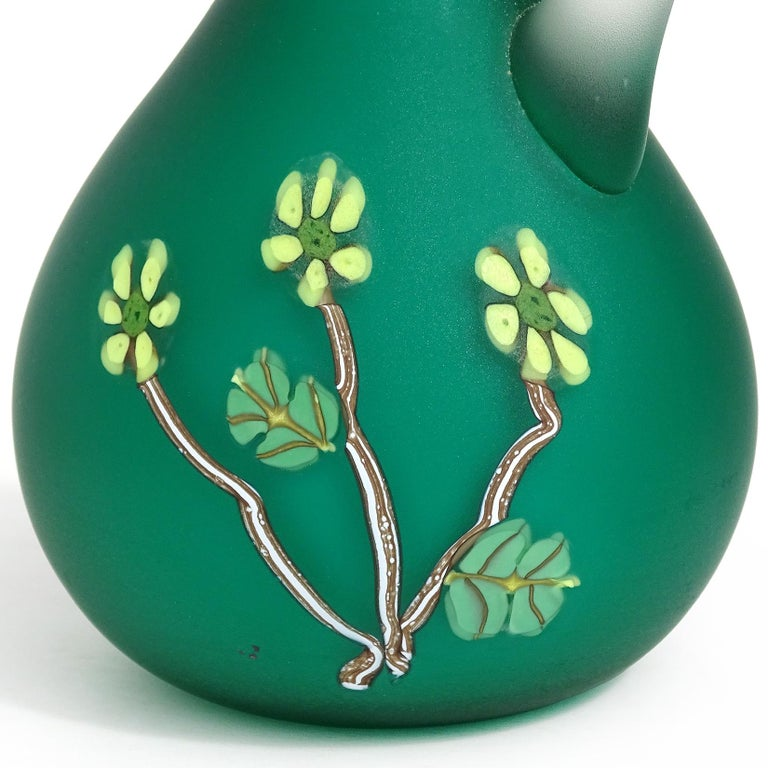 Beautiful vintage Murano hand blown green satin surface Italian art glass ewer cruet, with applied millefiori flowers decoration. Documented to the Fratelli Toso company. It is soft to the touch like velvet. The surface has yellow flowers and leafs