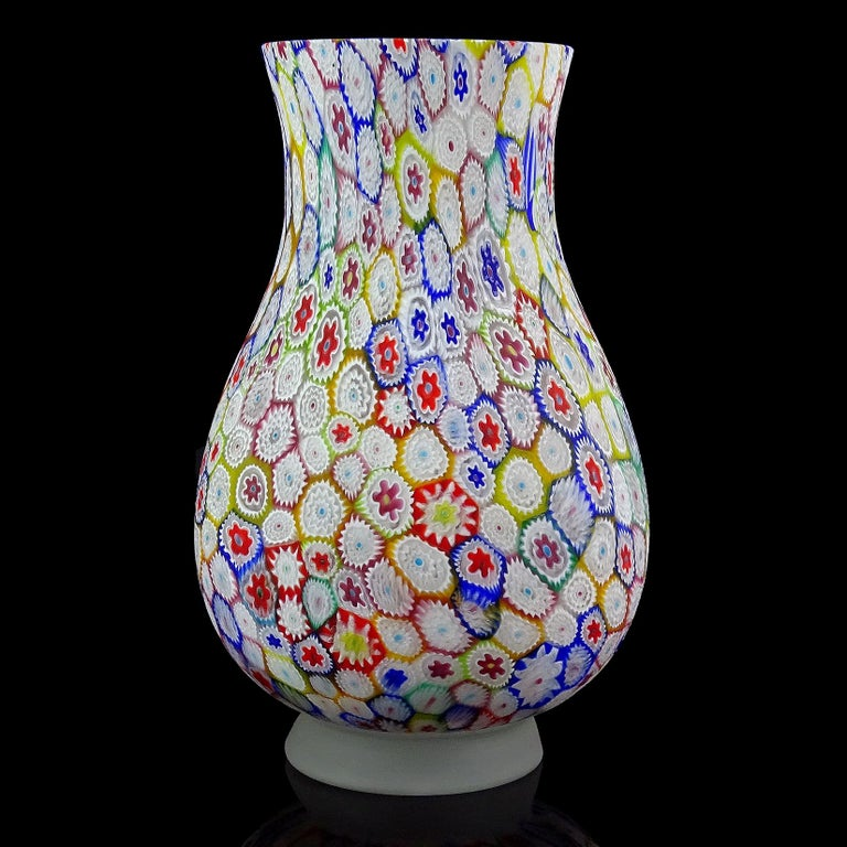 Beautiful, large vintage Murano hand blown millefiori, rainbow colors, mosaic Italian art glass flower vase. Documented to the Fratelli Toso Company. The piece has a great array of colors, with white, cobalt blue, sky blue, green, yellow, orange,