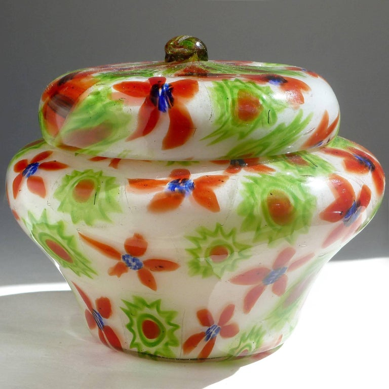 Beautiful and rare, antique Murano hand blown millefiori flower mosaic design Italian art glass vanity ring / powder box. Documented to the Fratelli Toso company, circa 1930s-1940s. Very unusual design over white, with transparent canes, which make