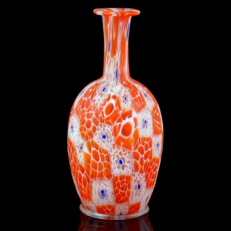 Beautiful antique Murano hand blown millefiori mosaic Italian art glass decorative cabinet vase. Documented to the Fratelli Toso Company, circa 1910-1920. Art Nouveau era. The vase has white with blue murrine flowers and orange beehive murrines. It