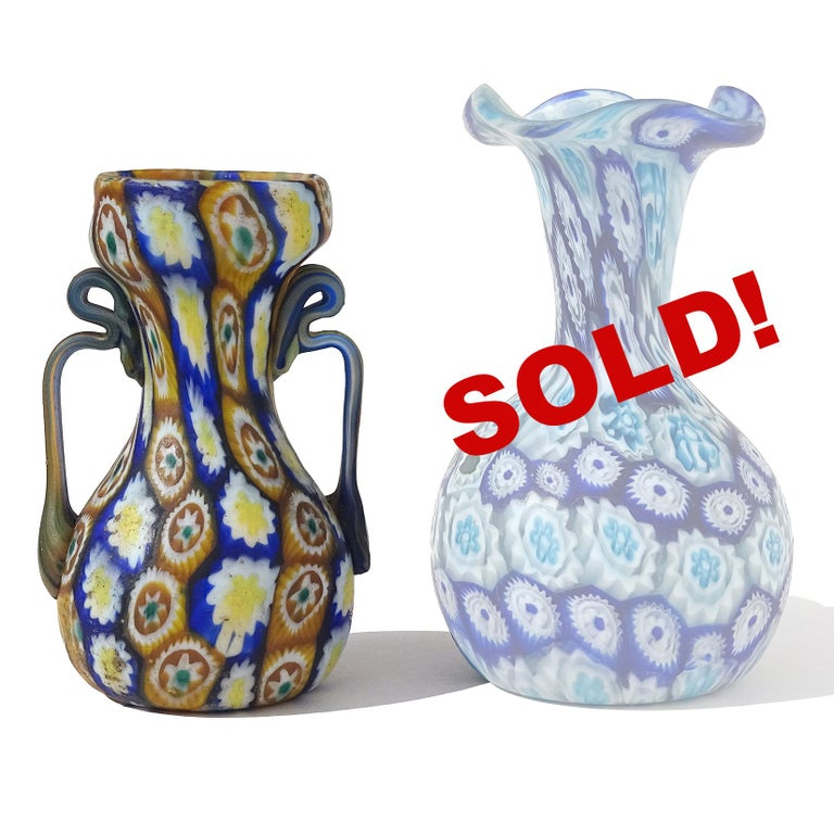ONLY 1 Left! Beautiful antique Murano hand blown millefiori mosaic Italian art glass decorative cabinet vase. Documented to the Fratelli Toso company, circa 1910-1930. The vase has orange, yellow, white and blue flowers, with ornate handles.