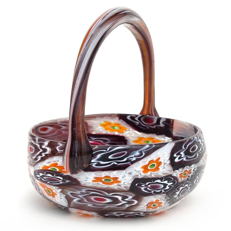 Beautiful antique murano hand blown dark purple / black, orange and white millefiori flower mosaic Italian art glass decorative basket. Documented to the Fratelli Toso Company, circa 1900-1920. Great contrasting colors. Would make a great ring dish.