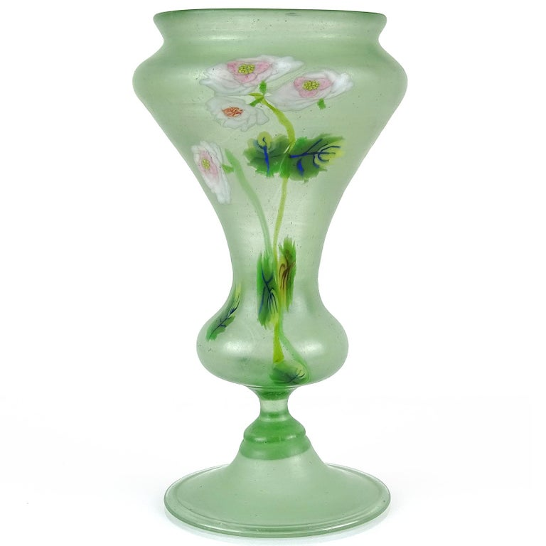 Gorgeous antique Murano hand blown light green Italian satin art glass millefiori flowers art glass decorative vase. Documented to the Fratelli Toso company. It has a unique shape and rare design, with white and pink roses and blue with yellow