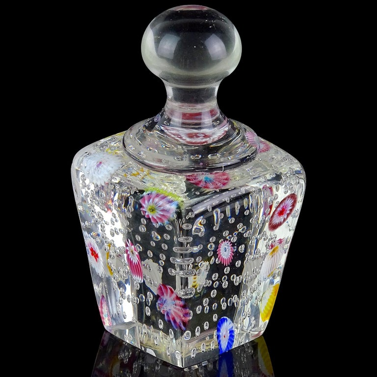 Beautiful Murano hand blown controlled bubbles and millefiori flowers Italian art glass paperweight. Documented to the Fratelli Toso Company. Still retains a