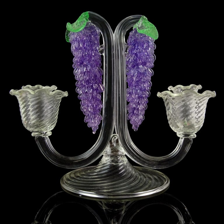 Beautiful large Murano hand blown purple Wisteria hanging flower Italian art glass crystal clear candlestick. Documented to the Fratelli Toso Company, model # 15366. Published in their book, with a photo of an old archive drawing. Has a Venetian,
