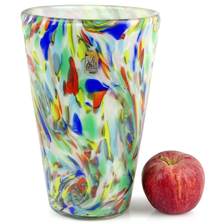 Beautiful large Murano handblown rainbow color swirls over white Italian art glass flower vase. Documented to the Fratelli Toso company, in the