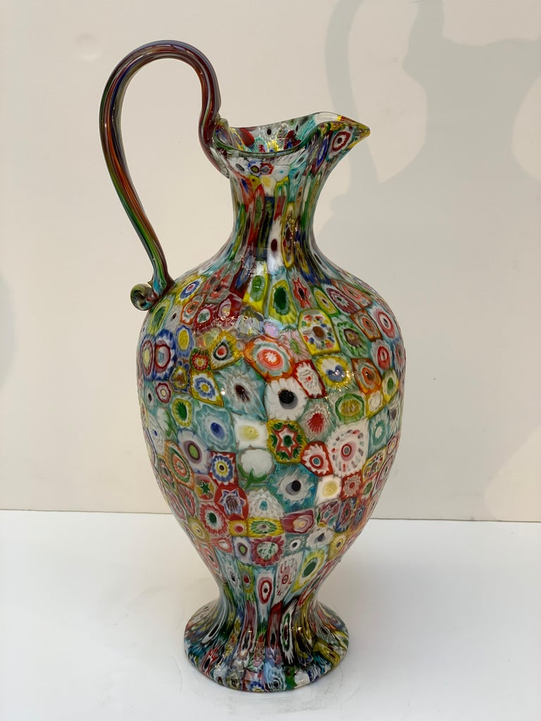 Exceptional Murano blown glass millefiori vase by Fratelli Toso early 1900s between 1900-1920 beautiful multicolored murrine with different glass pastes, the shape of the vase with base that widens at the bottom and the handle applied when hot is