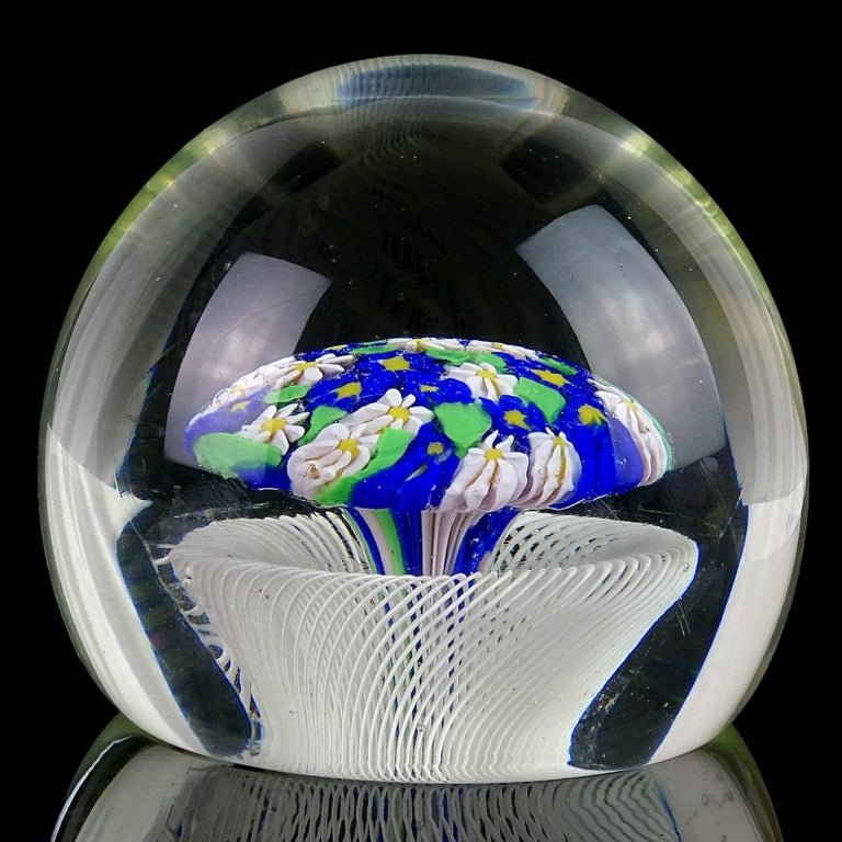 Intricate Murano handblown white ribbons basket, with very light pink and blue flower bouquet Italian art glass paperweight. Documented to the Fratelli Toso company, with original label underneath. Highly detailed piece. Collectors item. Measures 3