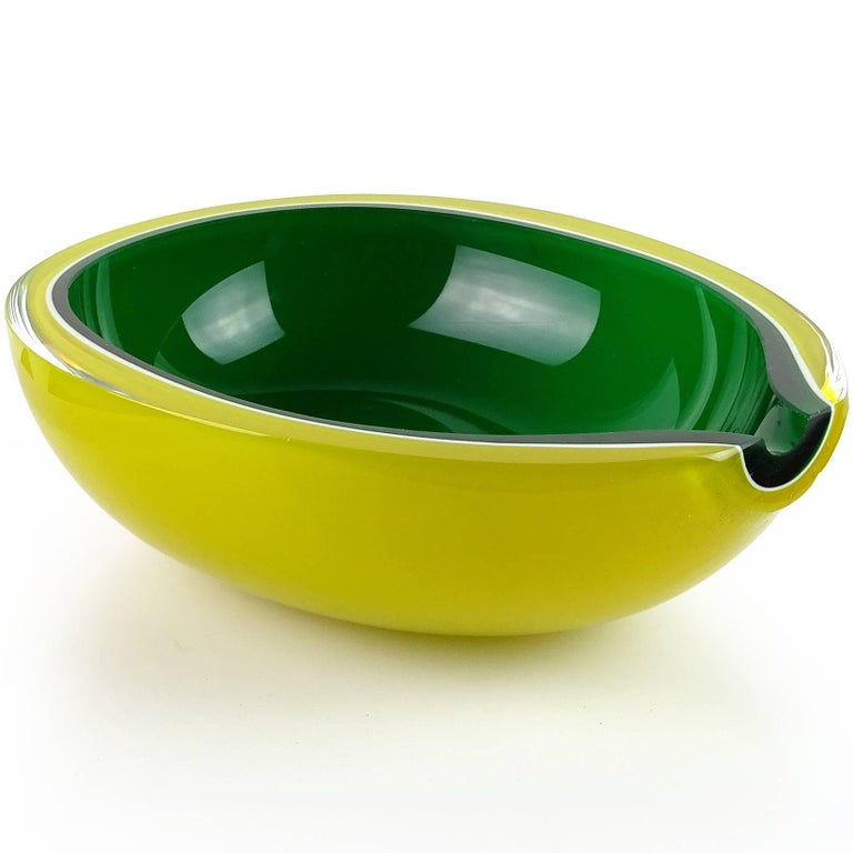 Beautiful and bright Murano hand blown yellow over green and white Italian art glass melon shaped bowl. Documented to the Fratelli Toso company. The piece has a flat rim, with a flat cut side (on purpose). It is made with 4 layers of glass. Gorgeous