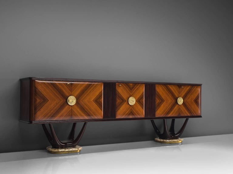 Fratelli Turri, credenza, in mahogany, maple, marble, glass and brass, Italy, 1950s.  This theatrical credenza is designed in the style of Vittorio Dassi. The cabinet itself is made of a mahogany construction. The doors are made of rosewood veneer,