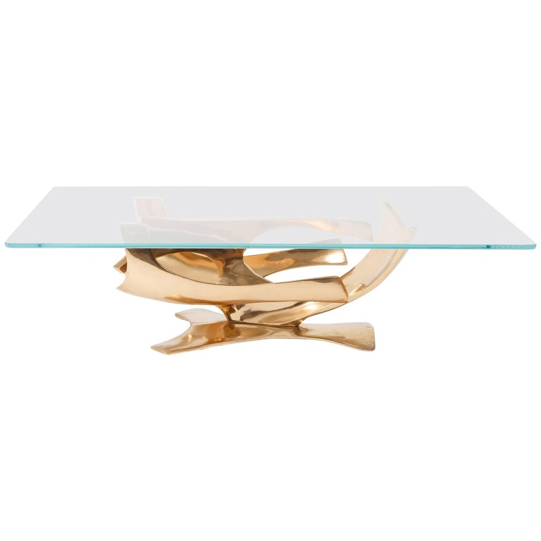 Coffee table with patinated gilt bronze sculptural base and plate glass top, France, circa 1970.  Signed 'F BROUARD' and numbered I / IV on the base.