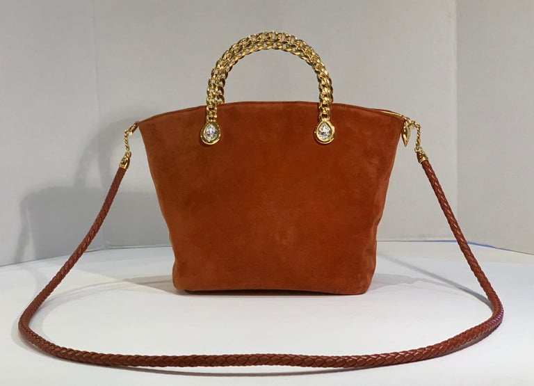 Luxurious, ultra-soft suede handbag or evening purse from Fred Hayman Beverly Hills, the creator of Giorgio Beverly Hills.  Small bucket style bag features large, pear shape Swarovski crystal embellishments, bezel set in shiny gold color metal