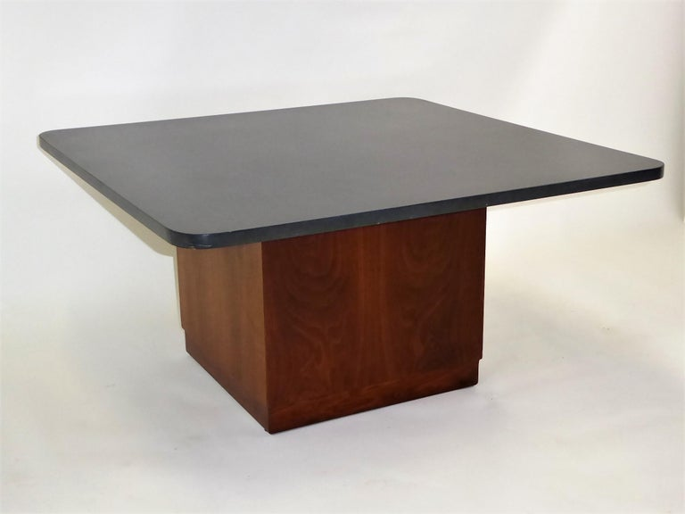 A Mid-Century Modern Coffee or Cocktail Table featuring a 1 inch thick square slate top with a square walnut base by St. Louis architect, Fred Kemp. Beautiful figured walnut veneers highlight this table. Neutral gray slate with rounded edges adds