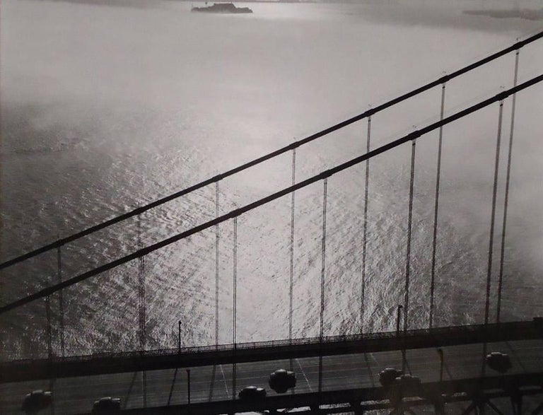 Fred Lyon Black and White Photograph - Golden Gate Bridge section aerial with Alcatraz near Upper Border