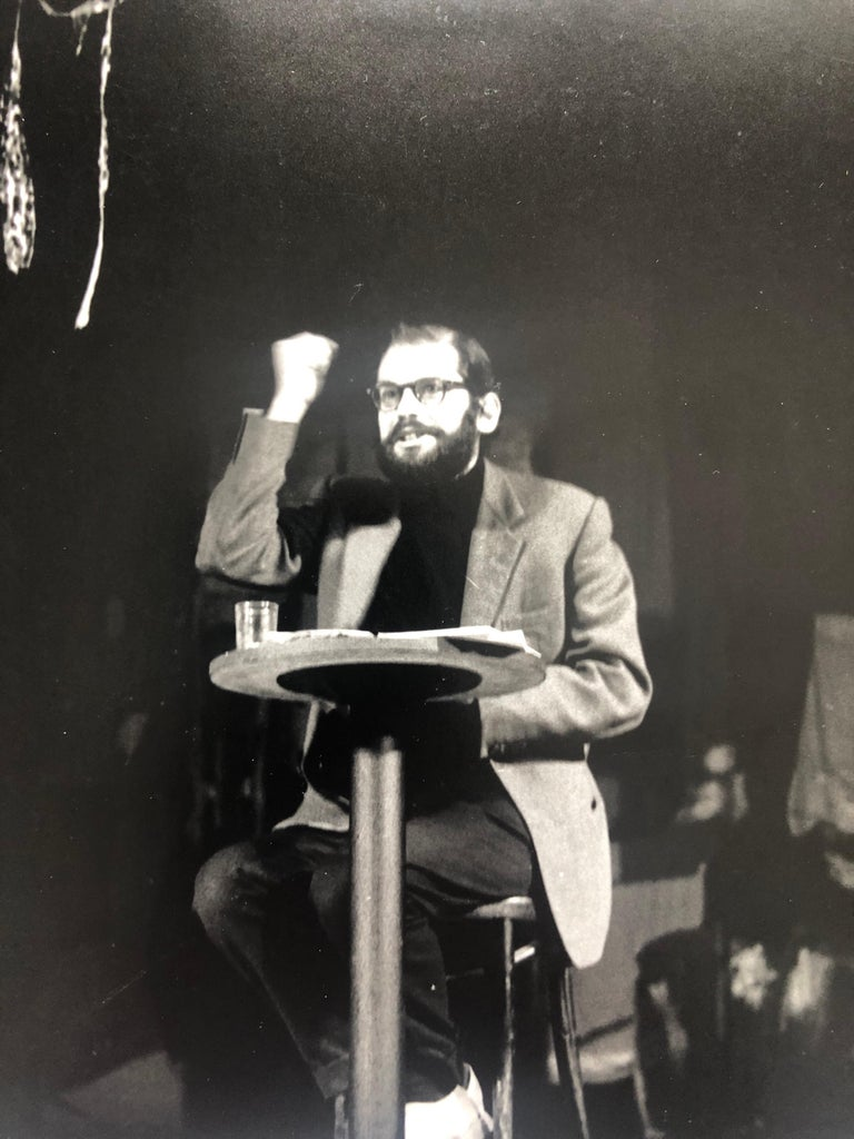 Allen Ginsberg reading Howl and other poems at Living Theater in 1959. signed in ink and with photographer stamp verso and hand written title. Irwin Allen Ginsberg 1926 – 1997 was an American poet, philosopher and writer. He is considered to be one