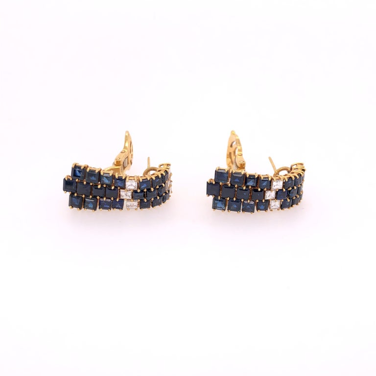 Exquisitely designed, these sapphire and diamond earrings from Fred of Paris are perfect for that special occasion. Princess cut sapphires are arrange in three staggered columns prong set in to 18K yellow gold post-clip earrings.  FRED of Paris was
