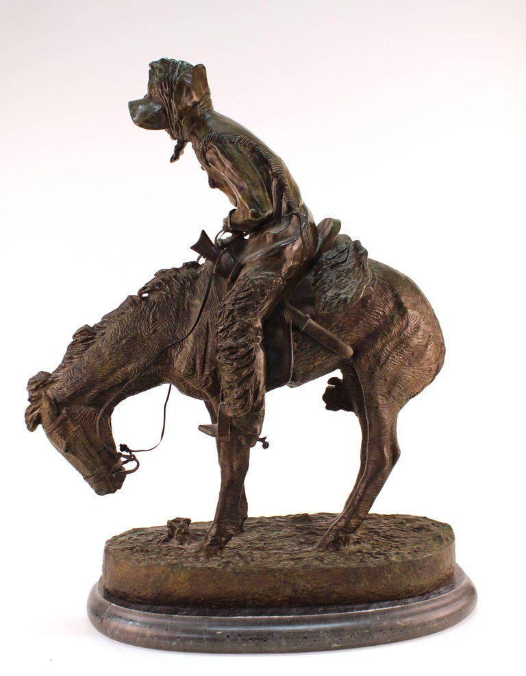 A detailed bronze sculpture by Frederic Remington, titled