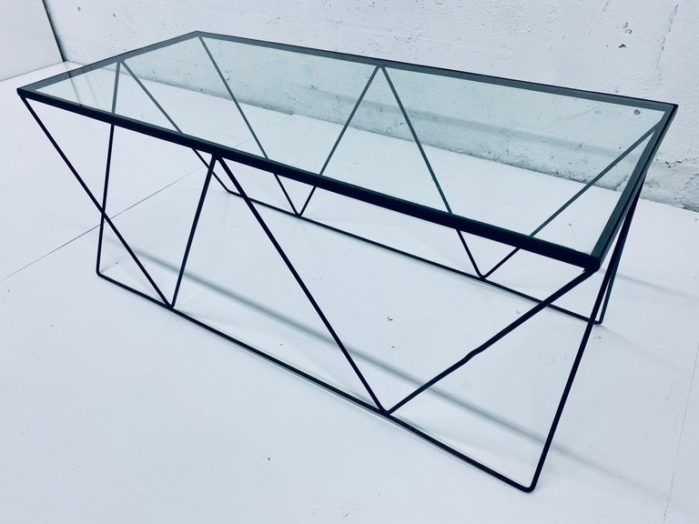 Styled after Frederick Weinberg / Arthur Umanoff, this petite coffee table is made of a wire frame with black lacquer and comes with the glass top. Original from the 1950s.