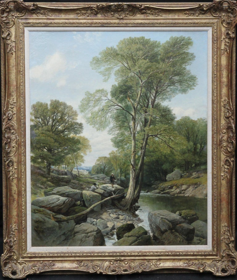 This charming Victorian landscape is by much exhibited British artist Frederick William Hulme. The painting is of two fishermen on large rocks by the edge of a river. They are stood under a tree with a landscape view in the background and a summer's