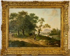 A river landscape with travellers on a path