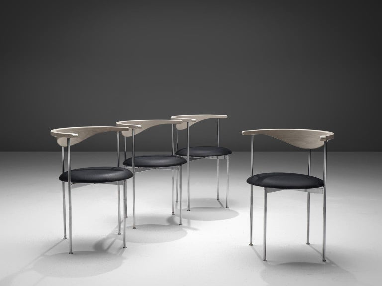 Frederik Sieck, four chairs, black skai, metal, lacquered wood, Denmark, design 1962, execution 1967.  These industrial clear set of the model 3200 chairs were designed by the Swedish Frederik Sieck for Fritz Hansen. The round chair has a Classic