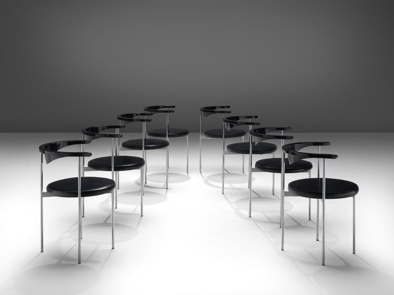 Frederik Sieck, ten chairs, black skai, metal, black wood, Denmark, design 1962, execution 1967.  These Industrial clear set of the model 3200 chairs were designed by the Swedish Frederik Sieck for Fritz Hansen. The round chair has a Classic