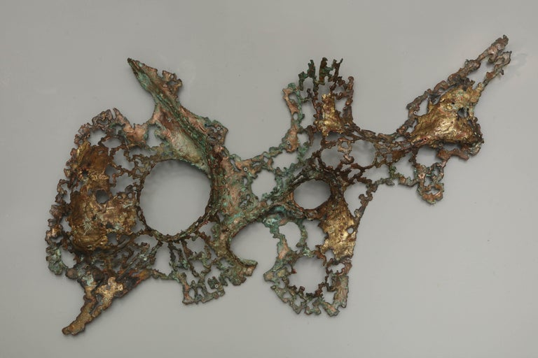 Organic Brutalist wall sculpture in unlacquered brass.