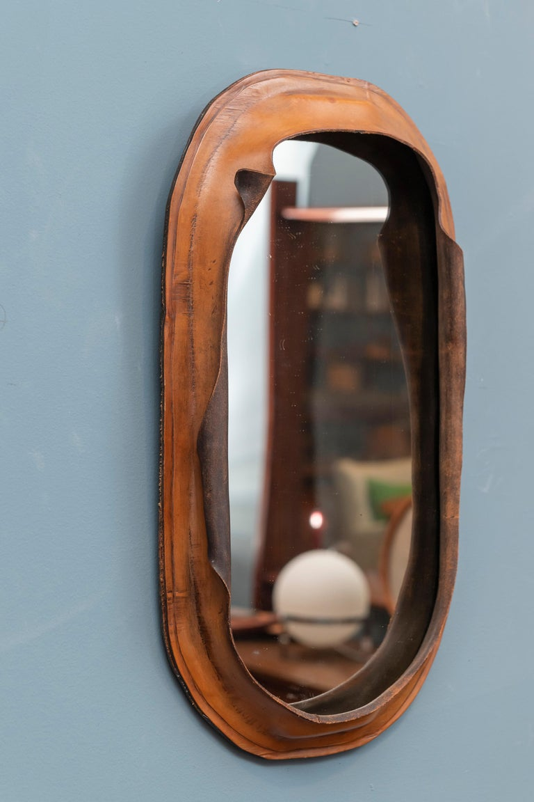 Freeform leather wall mirror, interesting design most likely from the 1970s and either French or Italian.