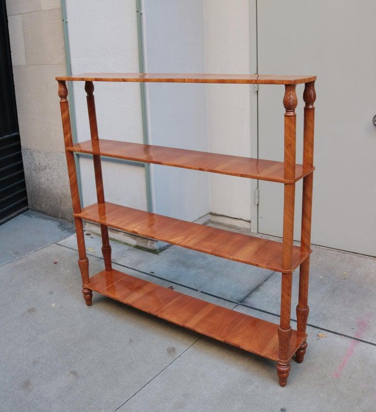A fine free standing Biedermeier shelf. Cherrywood with carved details.