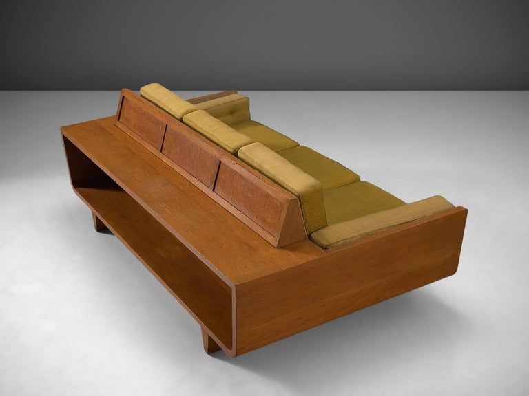 Sofa, walnut wood with green fabric, Italy, circa 1950.
