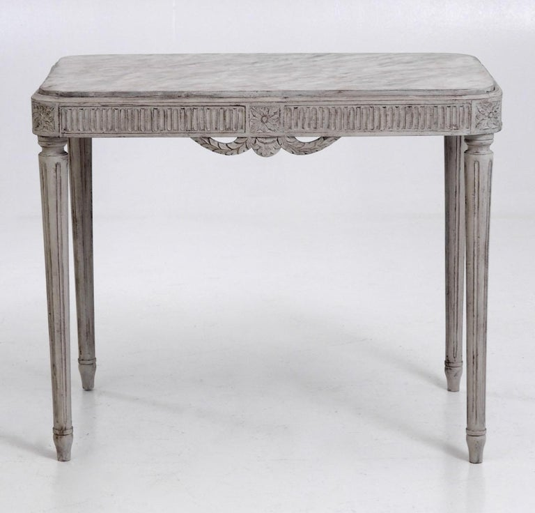 Fine freestanding Gustavian style console table, richly carved, with faux painted marble top, circa 100 years old.