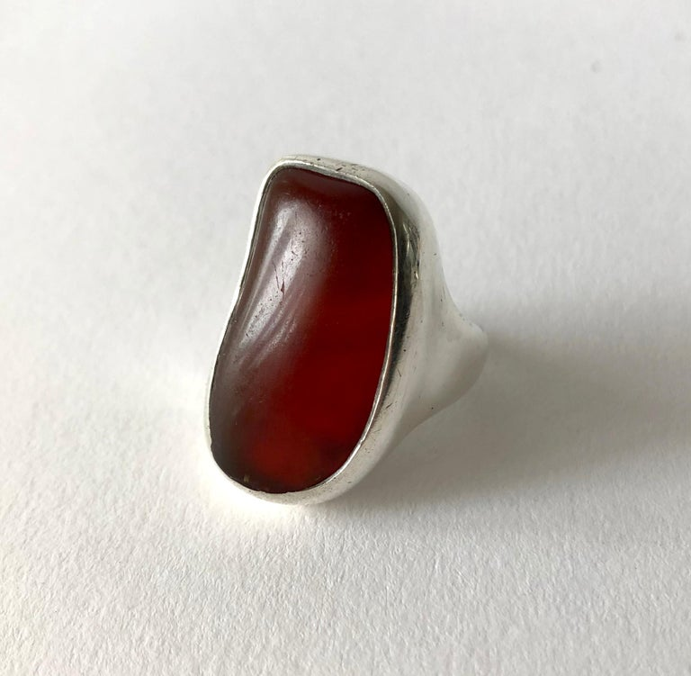 Sterling silver and amber gentlemens ring created by H. Fred Skaggs of Scottsdale, Arizona. Large amber stone and setting are amorphic in shape and completely hand made. Stone and silver do have wear. Stone has a divot and scratches which are