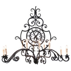 French 12-Light Wrought-Iron Chandelier with Clock Motif and Scrolling Armature