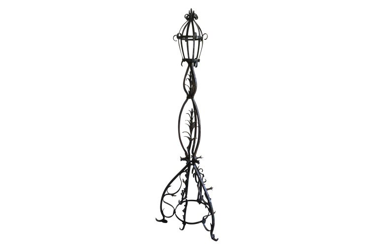 An outstanding late 16th century Torchere, standing lantern from the Avignon region of France. Expertly crafted from hand forged iron. Exceptional patina and stunning detail.