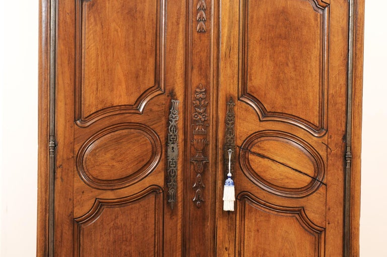 18th Century French 1740s Louis XV Walnut Armoire from Nice, with Hand Carved Foliage Décor For Sale